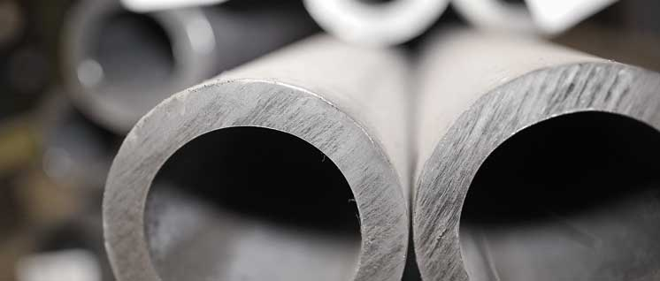 Hot-deformed seamless pipe stock for production of joint couplings